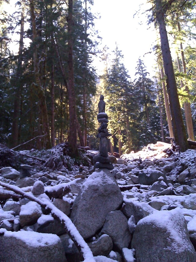 Rock cairn in wintry Middle Fork Snoqualmie forest.