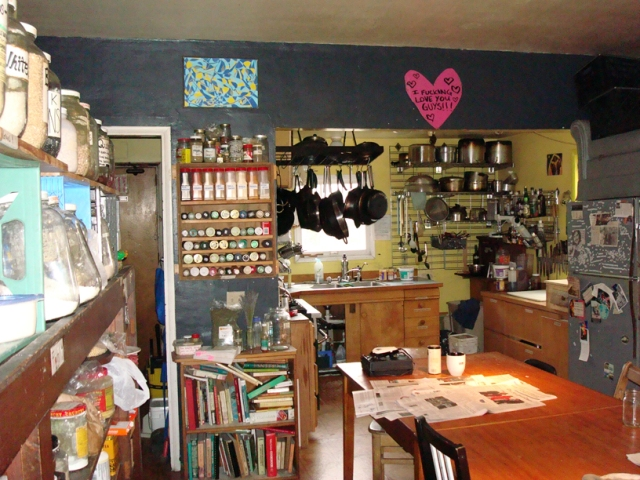The kitchen, the heart of Sherwood, circa 2009.  Note couch on top of fridges.