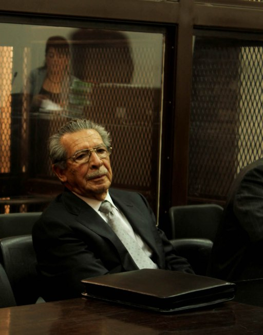 Efraín Ríos Montt in court on charges of genocide. Judge Carol Patricia Flores is reflected in the glass behind Ríos Montt. (Photo: Roderico Yool Diaz)
