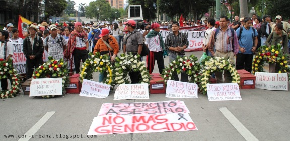 Protesters commemorate victims of the Guatemalan military's massacre in Totonicapán during a march for the Day of Indigenous Resistance (Photo via CPR-Urbana)