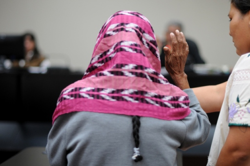 With her face covered, a survivor is sworn in by the court. Photo by Sandra Sebastián, via ACOGUATE